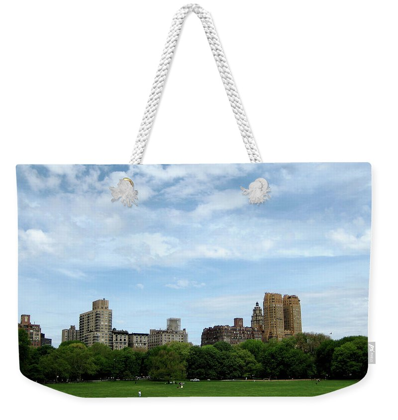 New York Weekender Tote Bag featuring the photograph Big Sky Nyc by Lorraine Devon Wilke