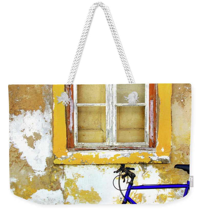 Aged Weekender Tote Bag featuring the photograph Bike Window by Carlos Caetano