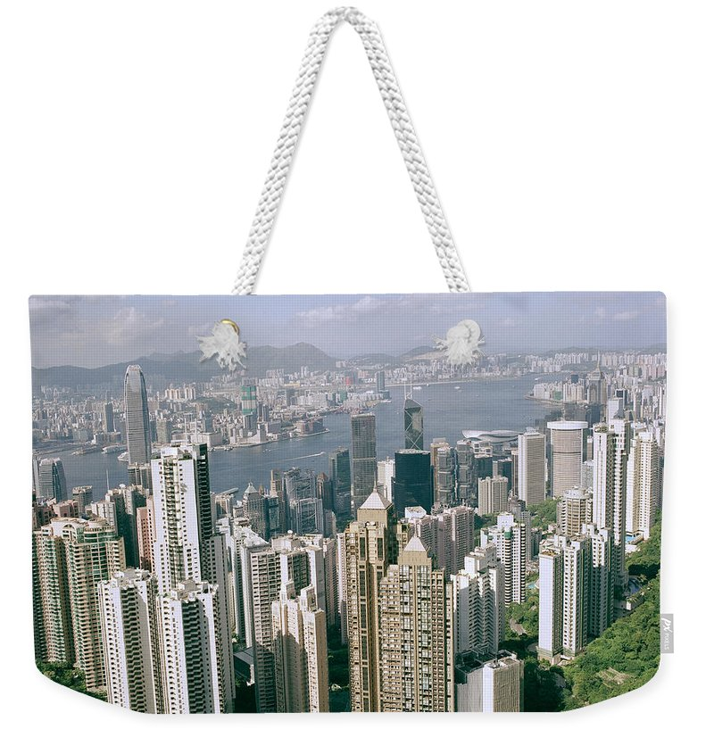 Color Weekender Tote Bag featuring the photograph Birds Eye View Over Hong Kong by Shaun Higson