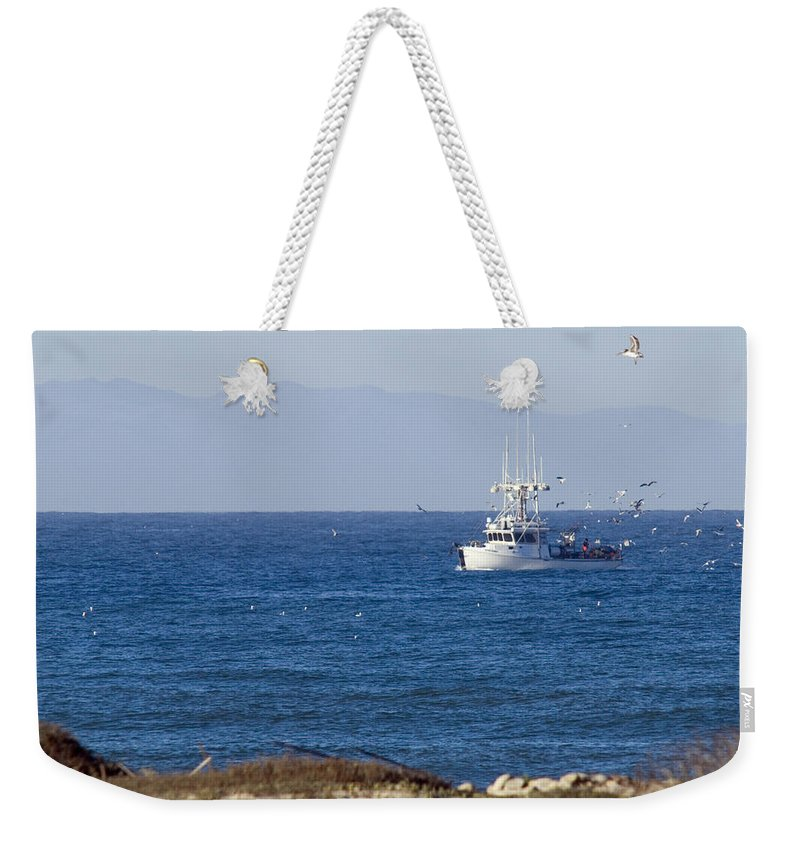 Emma Wood State Beach Weekender Tote Bag featuring the photograph Birds Flying Over A Commercial Fishing by Rich Reid