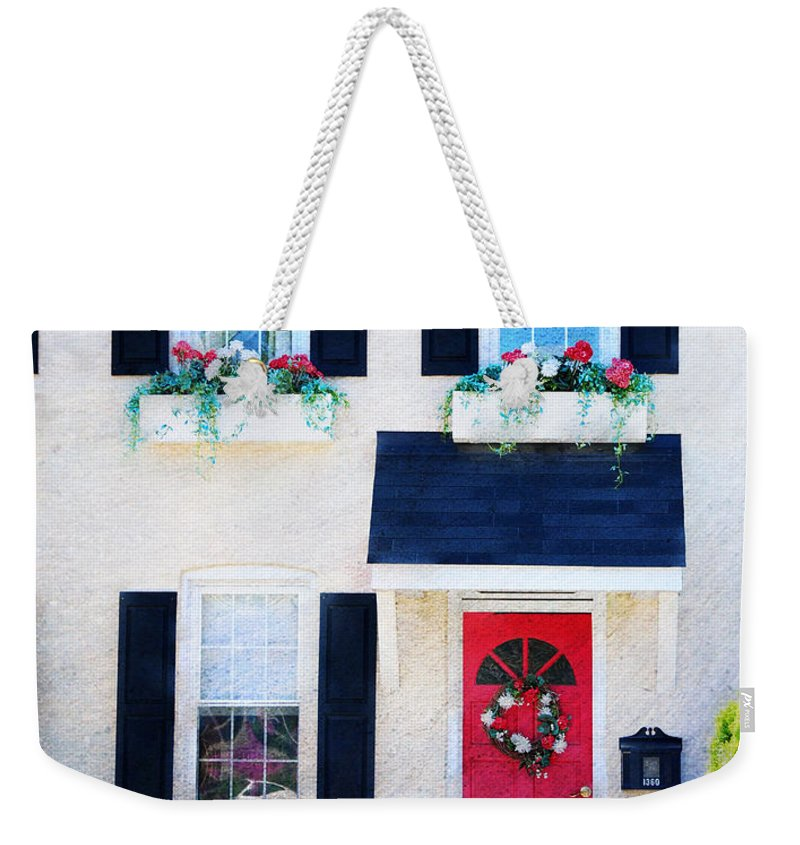 Red Weekender Tote Bag featuring the photograph Black Window Shutters With Flowers by Paul Ward