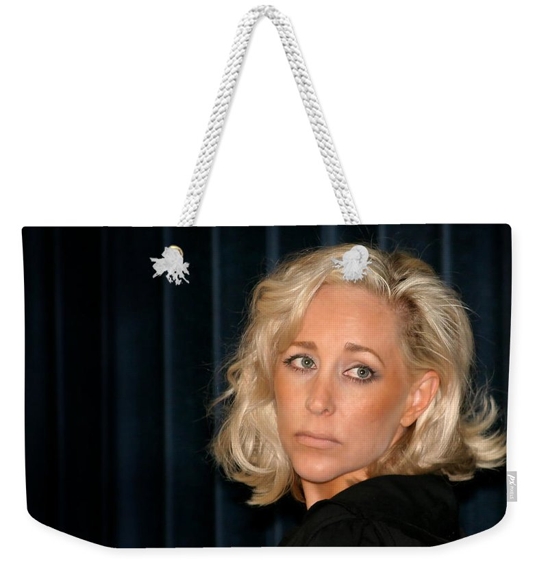 Young Weekender Tote Bag featuring the photograph Blond Woman Sad by Henrik Lehnerer