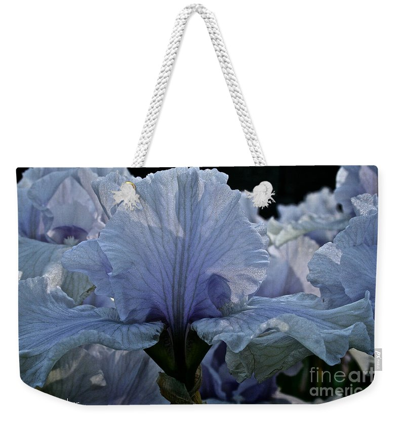 Plant Weekender Tote Bag featuring the photograph Blooming Iris by Susan Herber