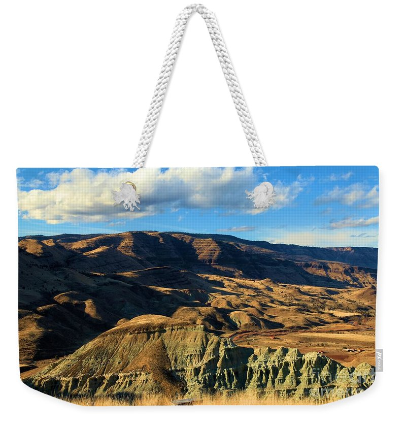 John Day Fossil Beds National Monument Weekender Tote Bag featuring the photograph Blue Basin Blue Skies by Adam Jewell