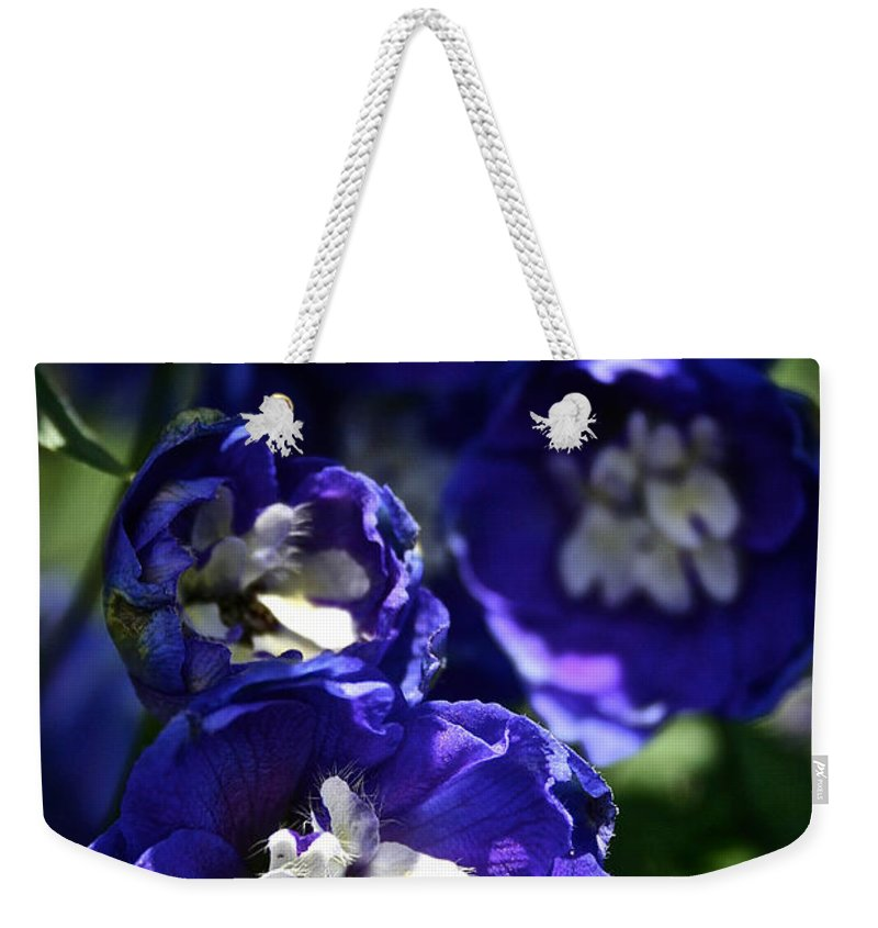 Garden Weekender Tote Bag featuring the photograph Blue Blossoms by Susan Herber