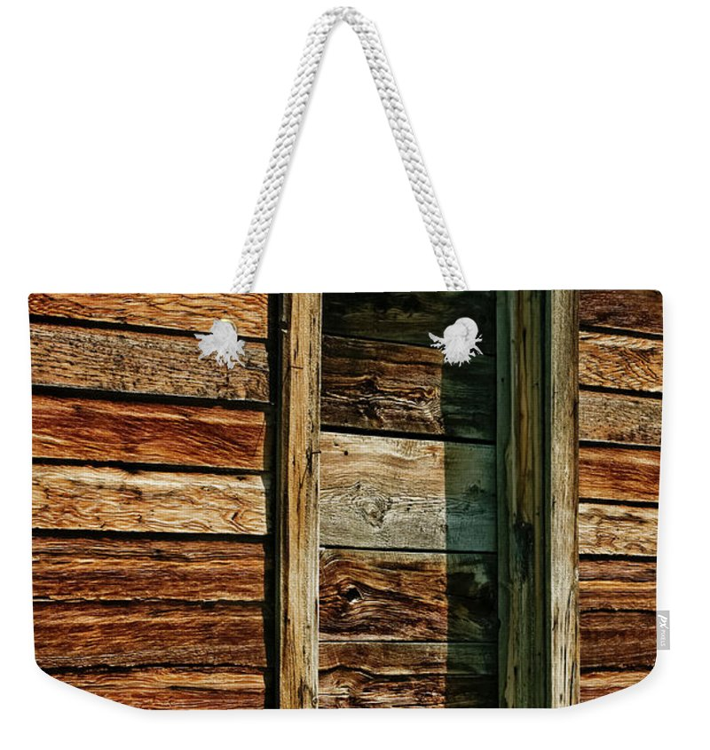 Americas Weekender Tote Bag featuring the photograph Boarded Doorway by Roderick Bley