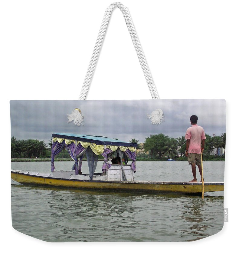 Boatman Weekender Tote Bag featuring the photograph Boatman Taking A Couple Out On A Shikhara by Ashish Agarwal