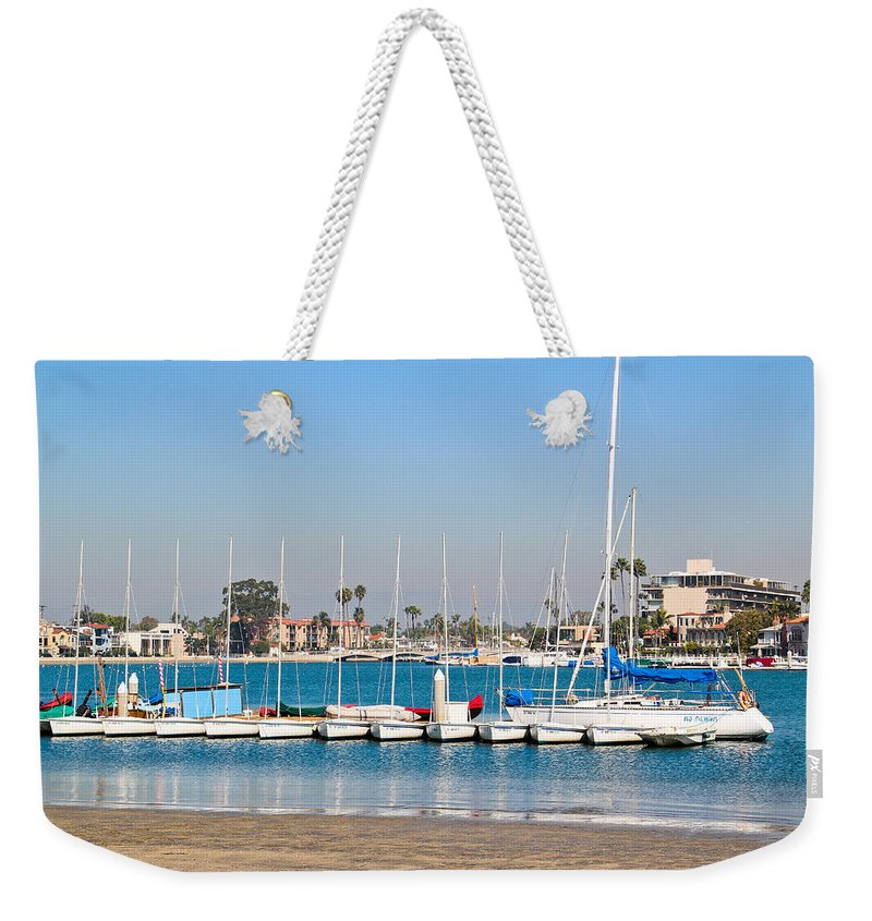Boats Weekender Tote Bag featuring the photograph Boats And Blue Water by Heidi Smith
