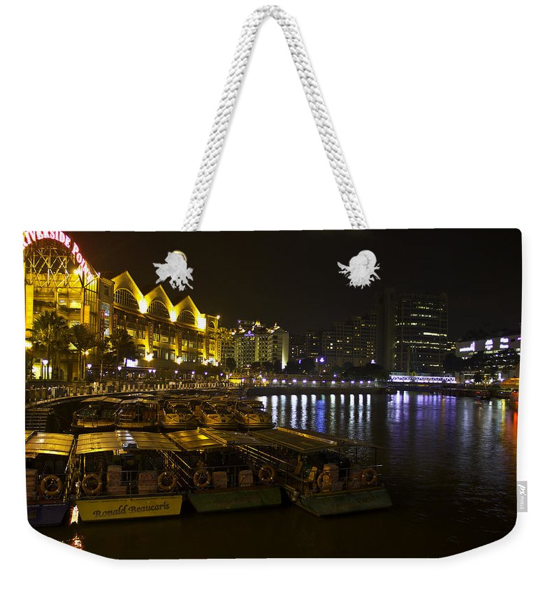 Asia Weekender Tote Bag featuring the photograph Boats Moored To The Side At Clarke Quay In Singapore by Ashish Agarwal