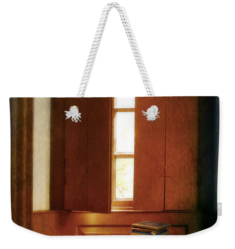Interior Weekender Tote Bag featuring the photograph Books On A Window Seat by Jill Battaglia