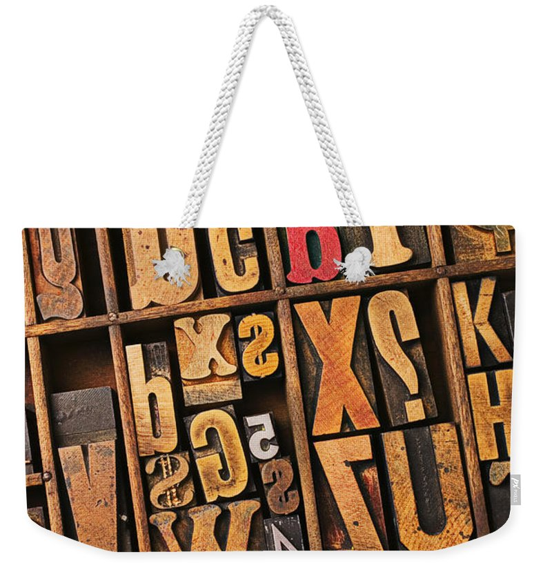 Type Weekender Tote Bag featuring the photograph Box Of Old Wooden Type Setting Blocks by Garry Gay