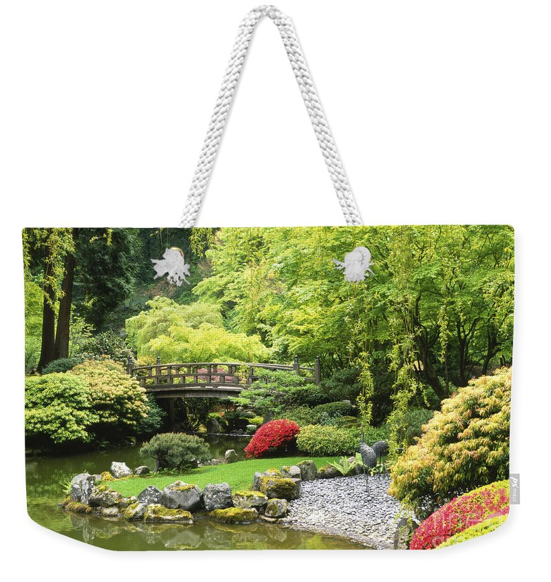 Japanese Garden Weekender Tote Bag featuring the photograph Bridge To Tranquility by Sandra Bronstein