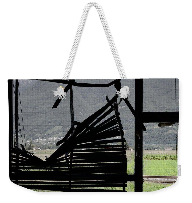 Window Weekender Tote Bag featuring the photograph Broken Window by Mats Silvan