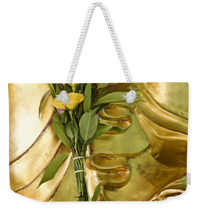 Buddha Weekender Tote Bag featuring the photograph Buddha Hand Holding Flower by Michele Burgess