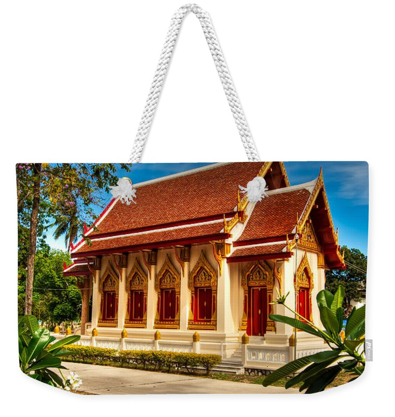 Architecture Weekender Tote Bag featuring the photograph Buddhist Temple by Adrian Evans