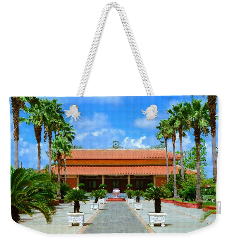 Buddha Weekender Tote Bag featuring the photograph Buddhist Temple In Houston by David Morefield