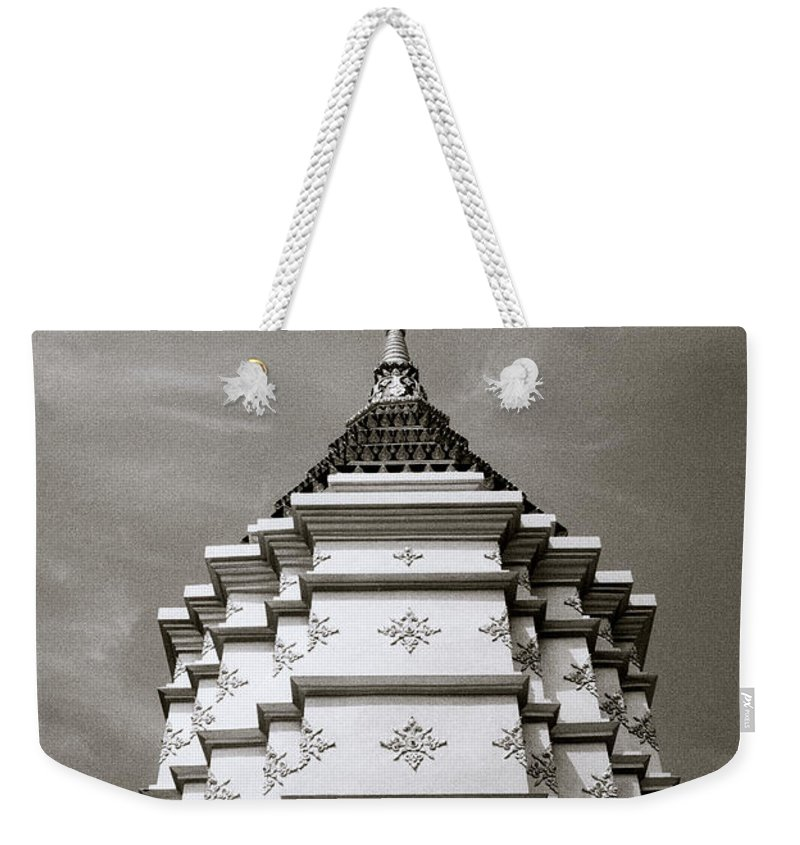 Asia Weekender Tote Bag featuring the photograph Buddhist Temple Wat Luang In Chiang Khong In Thailand by Shaun Higson