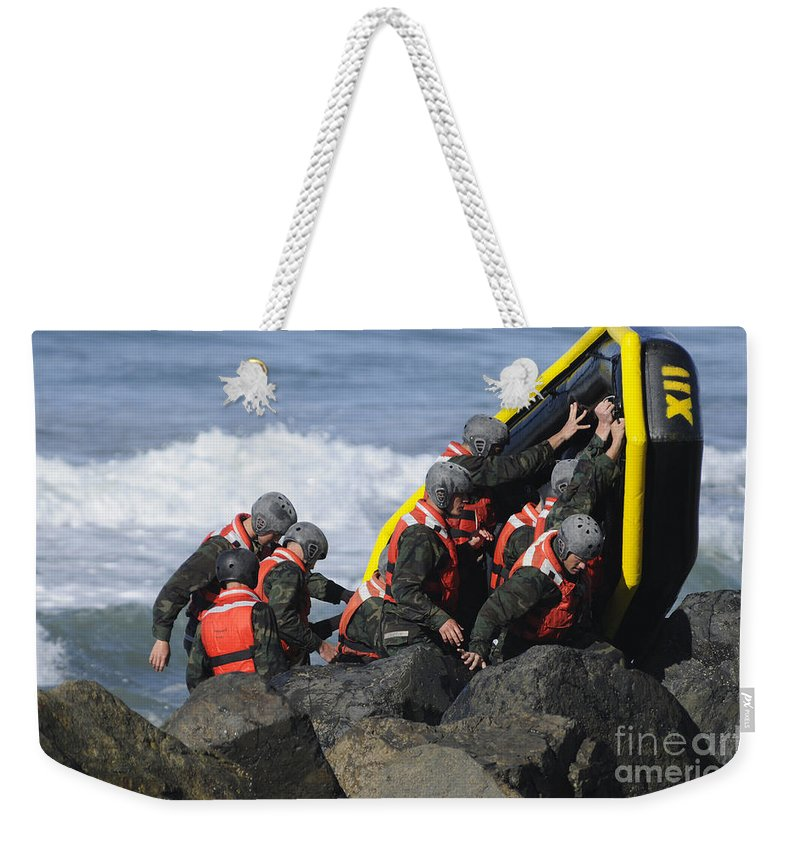 Special Warfare Weekender Tote Bag featuring the photograph Buds Participate In Rock Portage by Stocktrek Images