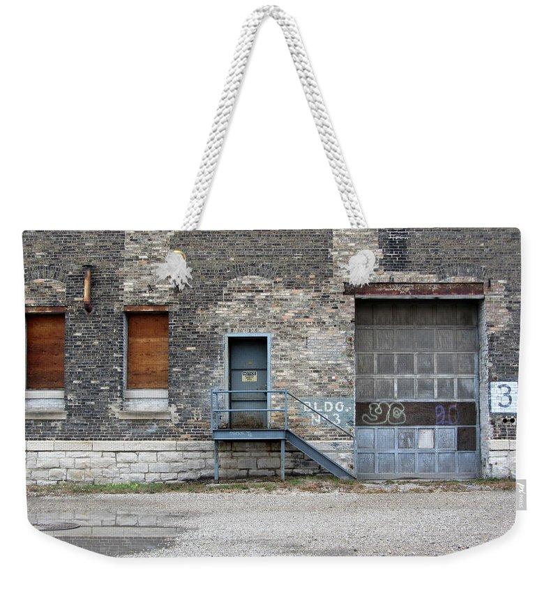 Milwaukee Weekender Tote Bag featuring the photograph Building No.3 Garage Door by Anita Burgermeister