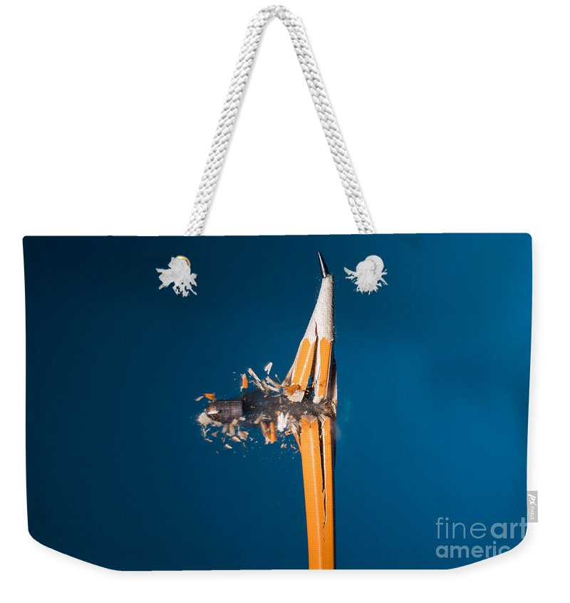 Bullet Weekender Tote Bag featuring the photograph Bullet Hitting A Pencil by Ted Kinsman