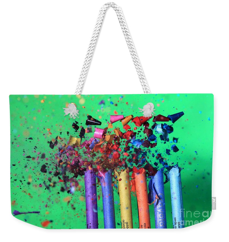 Science Weekender Tote Bag featuring the photograph Bullet Hitting Crayons by Ted Kinsman