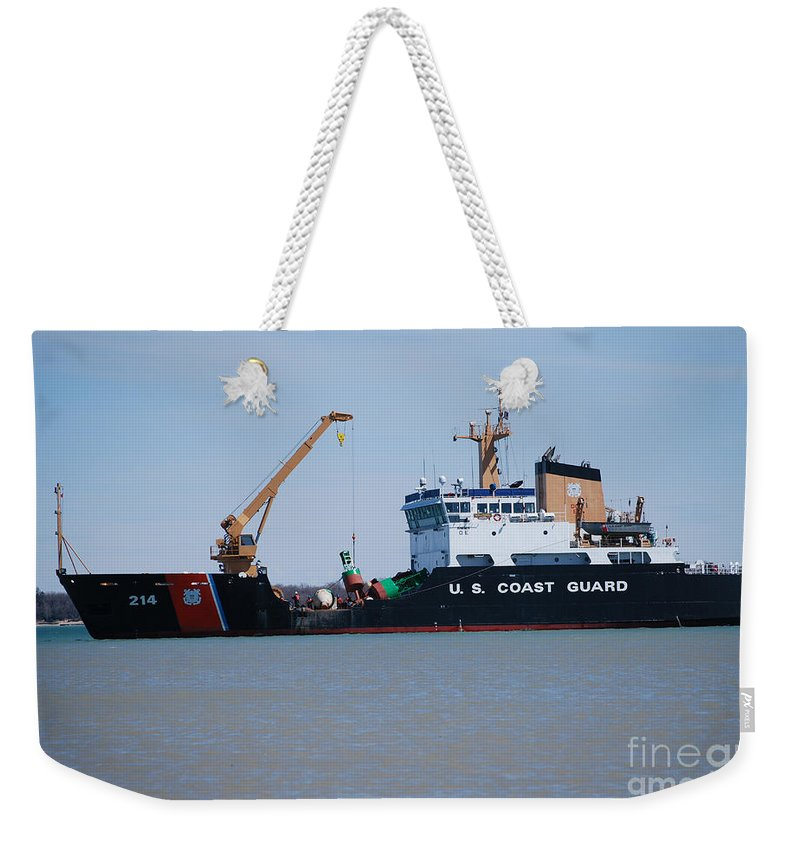 Buoy Changing Weekender Tote Bag featuring the photograph Buoy Changing by Grace Grogan