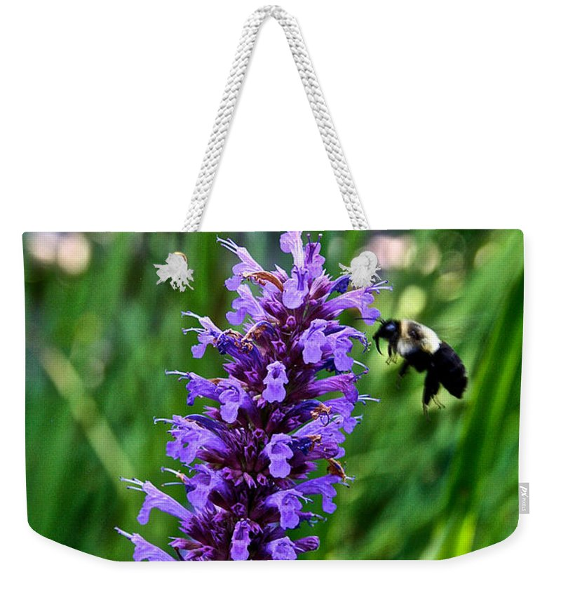 Outdoors Weekender Tote Bag featuring the photograph Buzzing Hyssop by Susan Herber