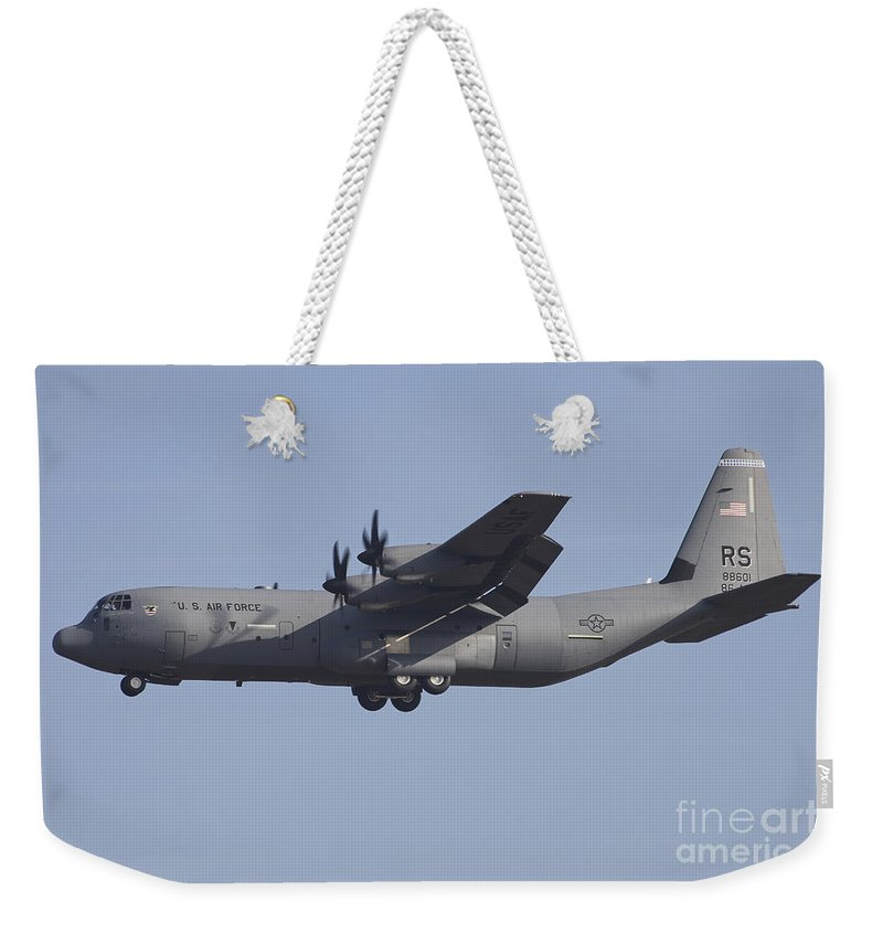 Horizontal Weekender Tote Bag featuring the photograph C-130j Super Hercules Of The 86th by Timm Ziegenthaler