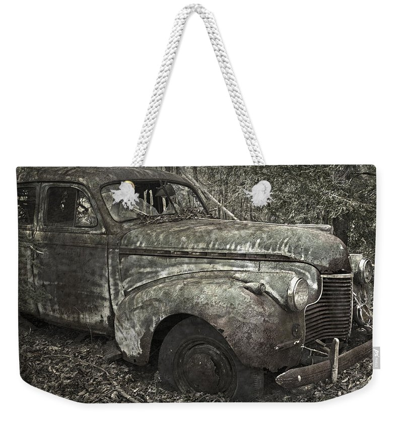 Rustbuckets Weekender Tote Bag featuring the photograph Camouflage Classic Car by John Stephens