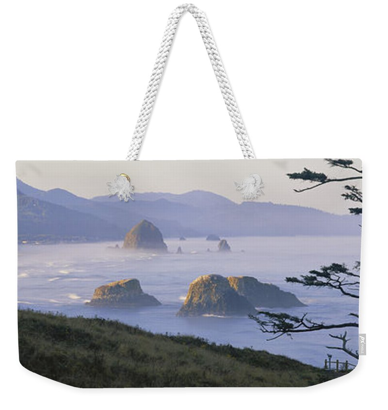 Nature Weekender Tote Bag featuring the photograph Cannon Beach by Chromosohm Media Inc and Photo Researchers
