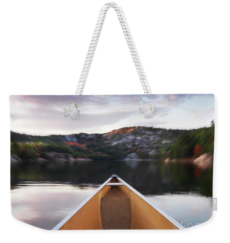 Canoe Weekender Tote Bag featuring the photograph Canoeing In Ontario Provincial Park by Oleksiy Maksymenko