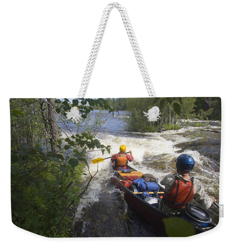 Two People Weekender Tote Bag featuring the photograph Canoeists Run A Rapid On The Winisk by Skip Brown