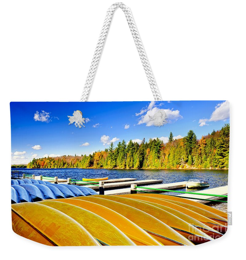 Canoes Weekender Tote Bag featuring the photograph Canoes On Autumn Lake by Elena Elisseeva