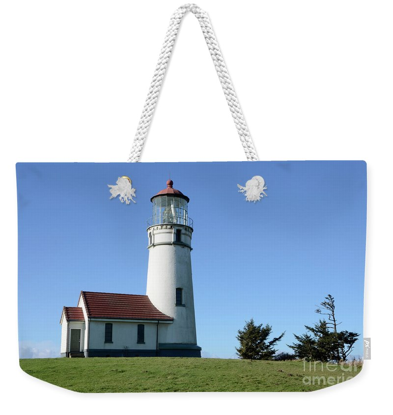 Pacific Ocean Weekender Tote Bag featuring the photograph Cape Blanco Lighthouse 1 by Bob Christopher