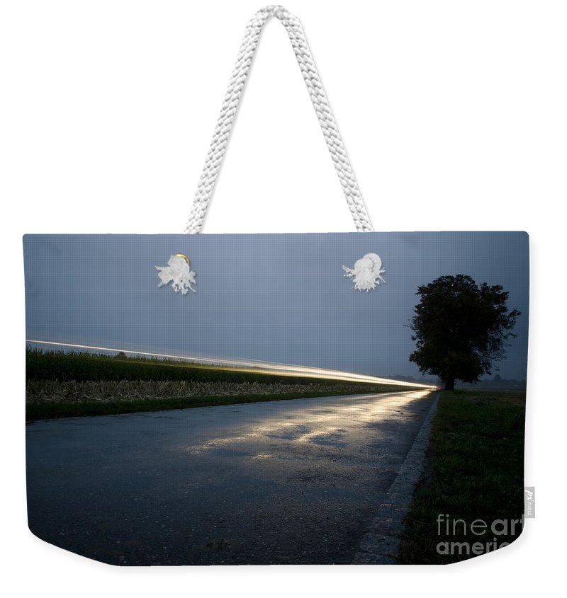 Car Weekender Tote Bag featuring the photograph Car Lights At Night by Mats Silvan