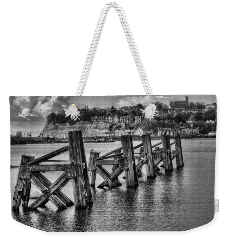 Cardiff Bay Jetty Weekender Tote Bag featuring the photograph Cardiff Bay Old Jetty Supports Mono by Steve Purnell