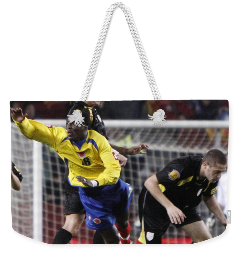 Carles Weekender Tote Bag featuring the photograph Carles Puyol Jumping by Agusti Pardo Rossello