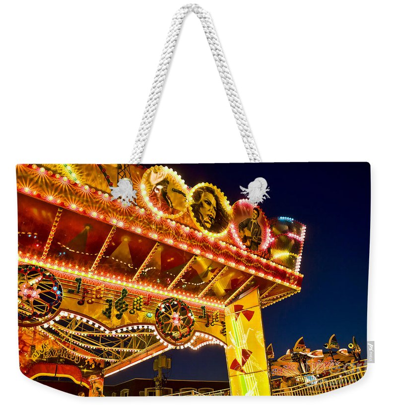 Boardwalk Weekender Tote Bag featuring the photograph Carnival Ride by John Greim