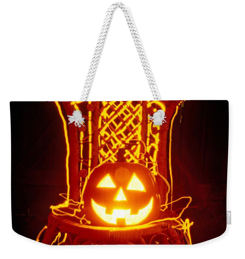 Pumpkin Weekender Tote Bag featuring the photograph Carved Smiling Pumpkin On Chair by Garry Gay