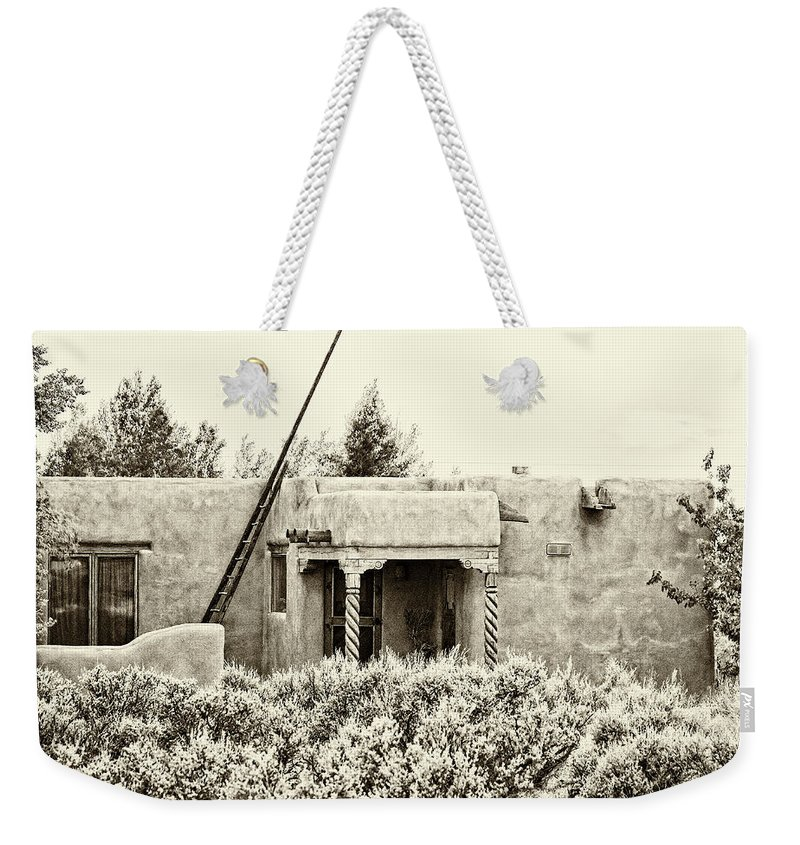 Santa Weekender Tote Bag featuring the photograph Casita In Taos Nm Old Print by Charles Muhle