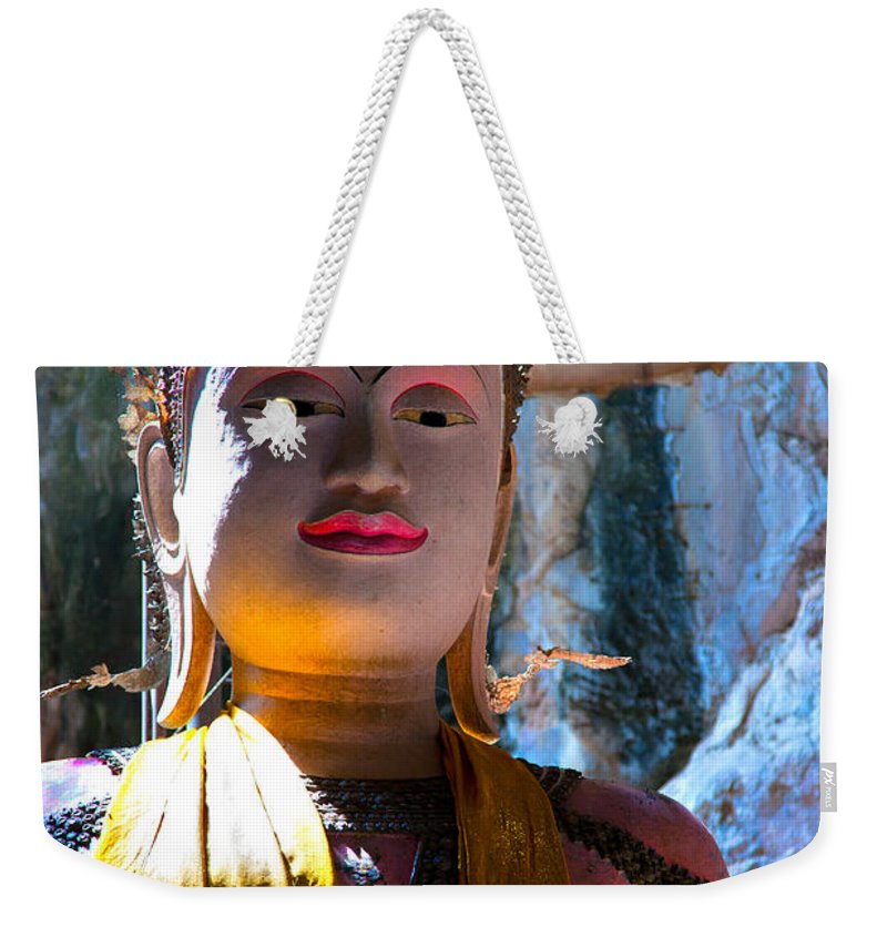 Ancient Weekender Tote Bag featuring the photograph Cave Buddha by Adrian Evans