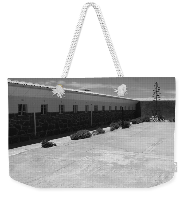 Robben Island Weekender Tote Bag featuring the photograph Prison Cell Row by Aidan Moran