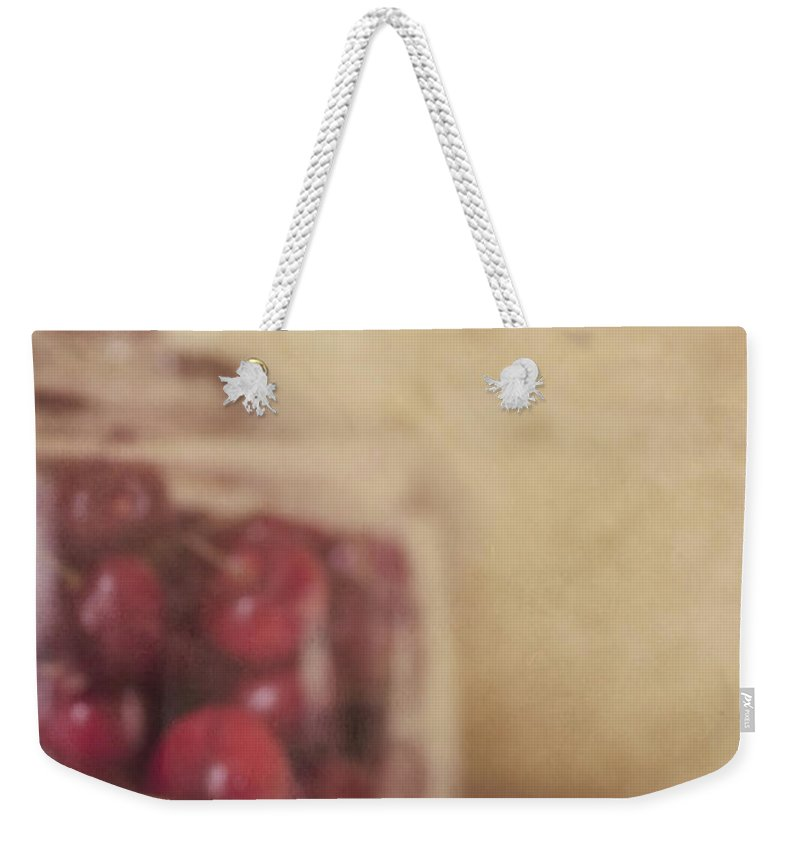 Cherry Weekender Tote Bag featuring the photograph Cerise by Priska Wettstein
