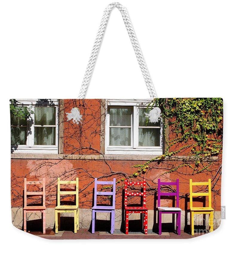 Hamlyn Weekender Tote Bag featuring the photograph Chairs At Hamlyn by Rob Hawkins