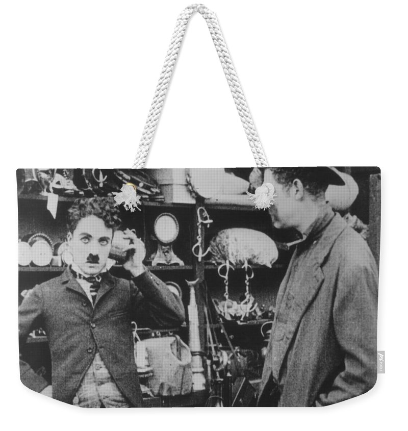 -nec04- Weekender Tote Bag featuring the photograph Chaplin: The Pawnshop by Granger