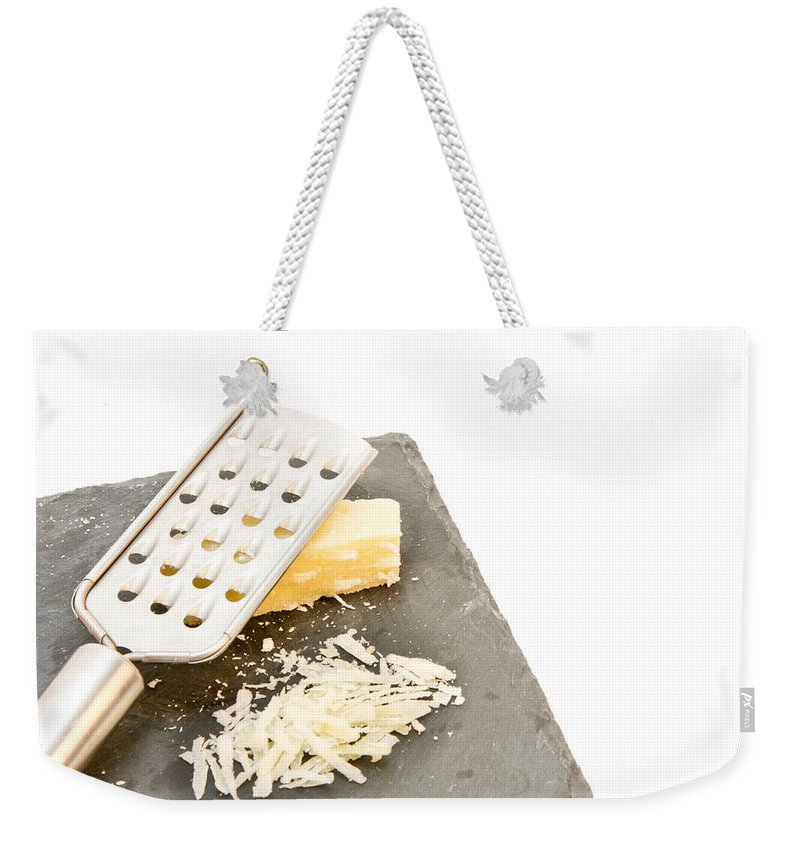 Background Weekender Tote Bag featuring the photograph Cheese Grater by Tom Gowanlock