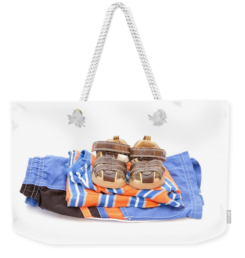 Background Weekender Tote Bag featuring the photograph Child's Clothing by Tom Gowanlock