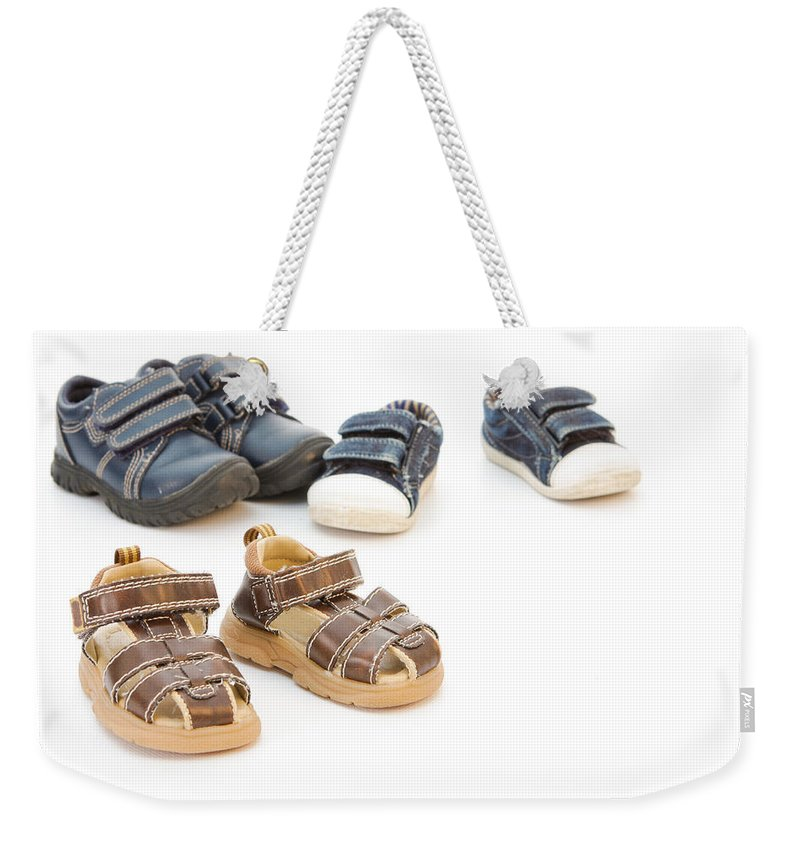 Background Weekender Tote Bag featuring the photograph Childs Shoes by Tom Gowanlock