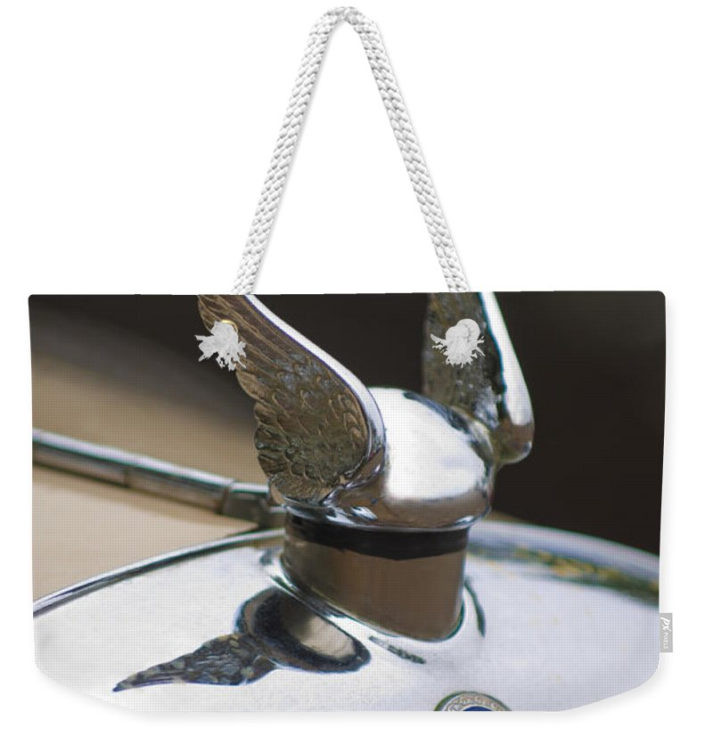 1920's Chrysler Weekender Tote Bag featuring the photograph Chrysler Hood Ornament 2 by Jill Reger
