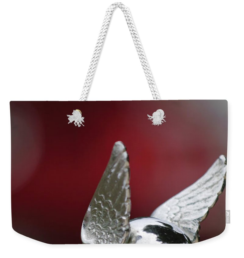 1920\'s Chrysler Weekender Tote Bag featuring the photograph Chrysler Hood Ornament by Jill Reger